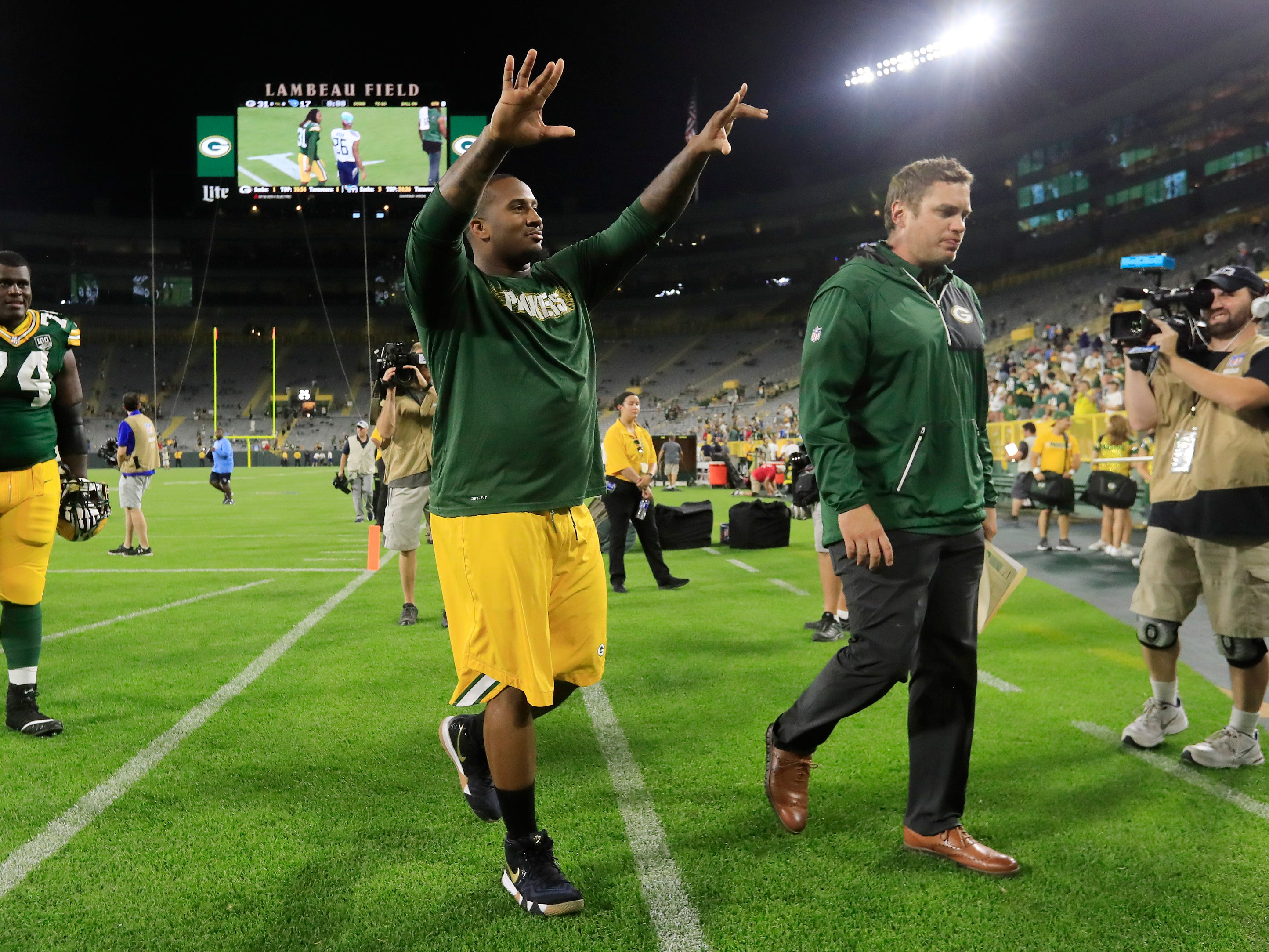 Green Bay Packers defensive tackle Mike Daniels (76) walks off the field after an NFL preseason game at Lambeau Field on Thursday, August 9, 2018 in Green Bay, Wis.