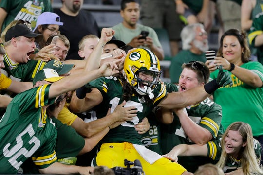 Green Bay Packers wide receiver Jake Kumerow (16) celebrates with a Lambeau Leap after scoring a touchdown against the Tennessee Titans in the fourth quarter an NFL preseason game at Lambeau Field on Thursday, August 9, 2018 in Green Bay, Wis.