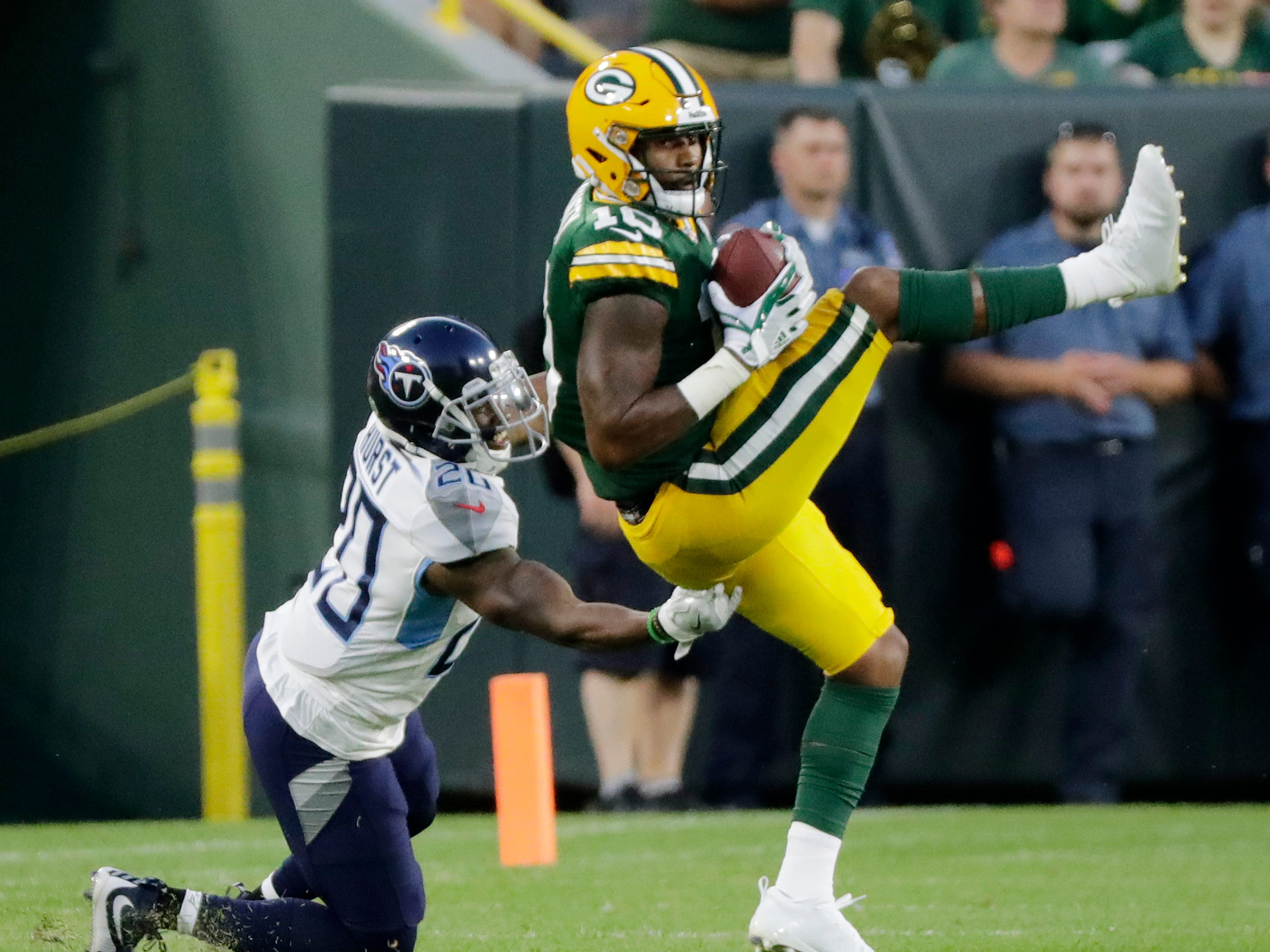 Green Bay Packers wide receiver DeAngelo Yancey (10) catches a pass against the Tennessee Titans in an NFL preseason game at Lambeau Field on Thursday, August 9, 2018 in Green Bay, Wis.