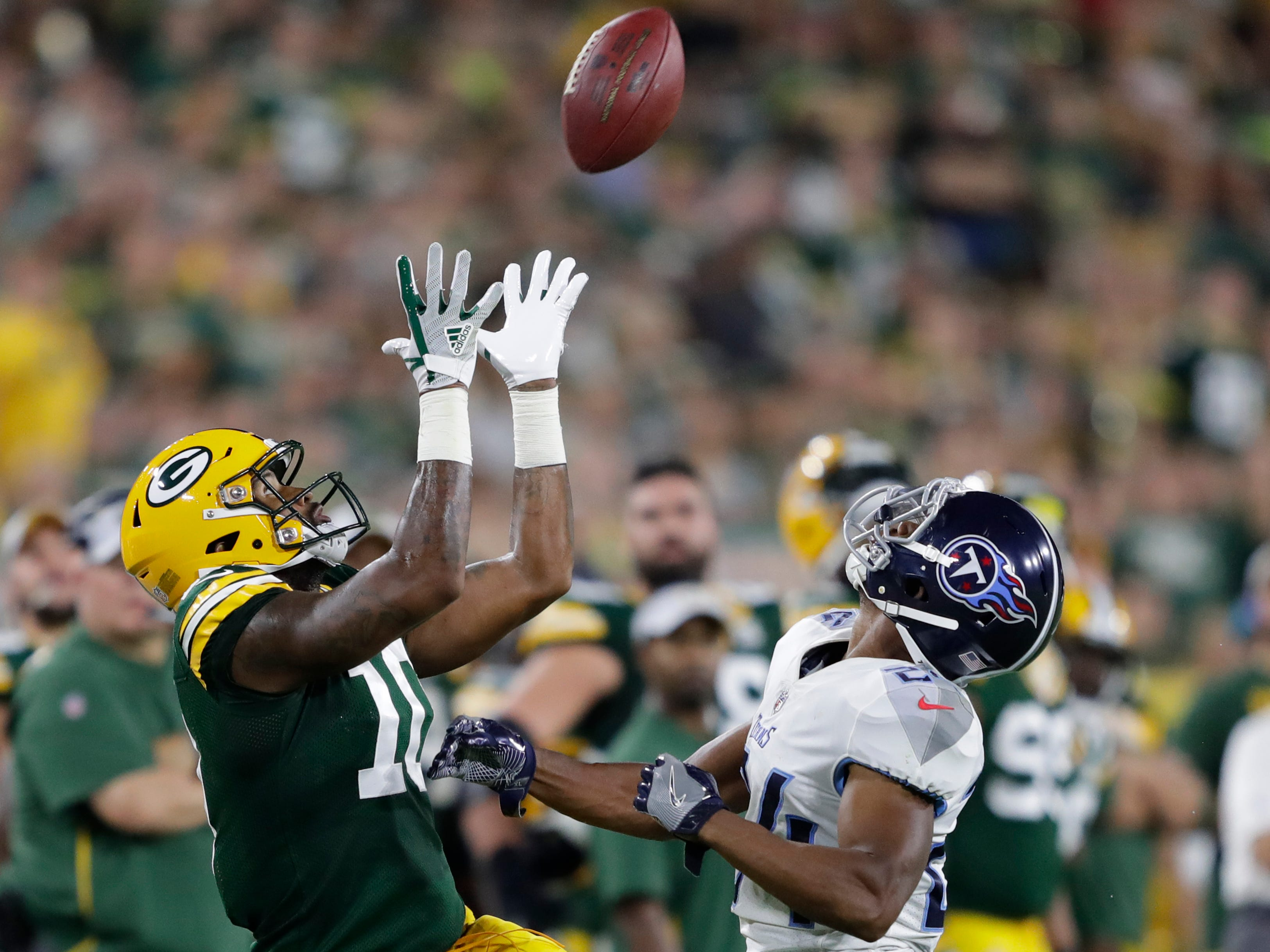 Green Bay Packers wide receiver DeAngelo Yancey (10) is out of bounds on a reception attempt against Tennessee Titans defensive back Kalan Reed (24) during their football game Thursday, August 9, 2018, at Lambeau Field in Green Bay, Wis.