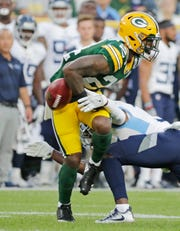 Green Bay Packers cornerback Quinten Rollins (24) fumbles a kick return in the first half against the Tennessee Titans in an NFL preseason game at Lambeau Field on Thursday, August 9, 2018 in Green Bay, Wis.