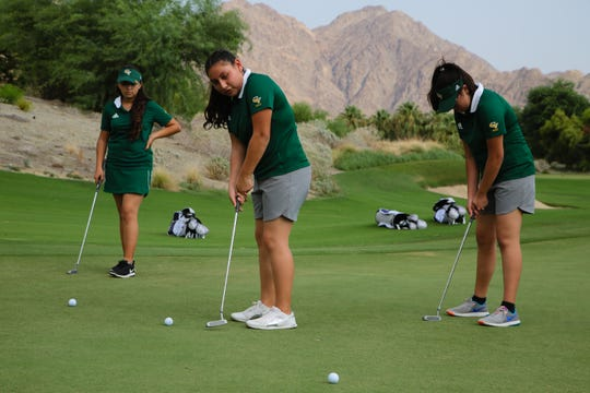 Zabdi Cruz of Coachella Valley High School putts with a new golf club donated by the Southern California PGA as part of the Clubs for Youth program, La Quinta, Calif., Friday, August 10, 2018.