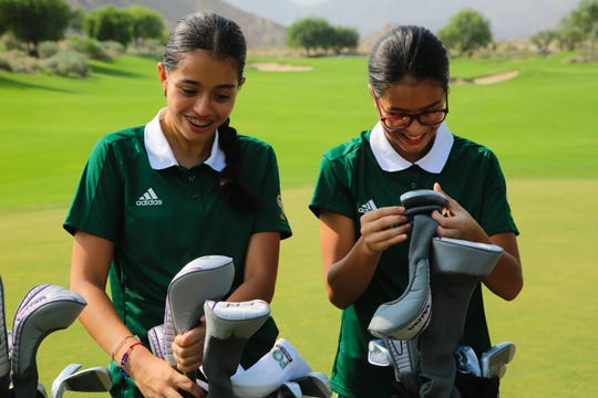 Monserrat Vargas, left, and her sister Cathy of Coachella Valley High School receive golf clubs donated by the Southern California PGA as part of the Clubs for Youth program, La Quinta, Calif., Friday, August 10, 2018.