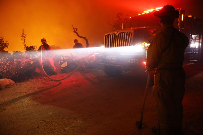 Firefighters work at the Holy Fire on August 10, 2018 near Lake Elsinore, California. The fire continues to grow amidst a heat wave and has now burned 10,236 acres while remaining just five percent contained.