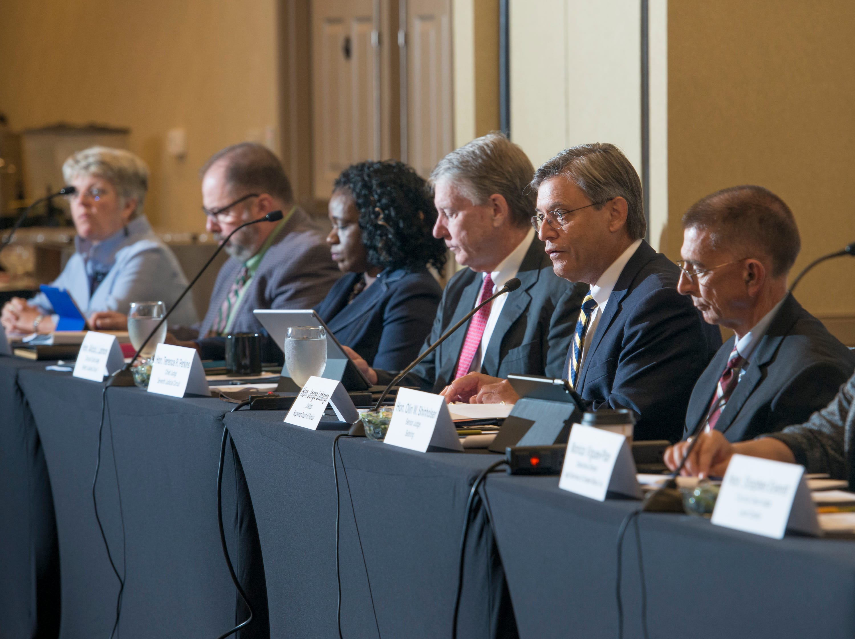 Supreme Court of Florida justice Jorge Labarga, second from right, speaks as the Florida Commission on Access to Civil Justice discusses veterans issues at the Hilton Garden Inn in Pensacola on Friday, August 10, 2018.