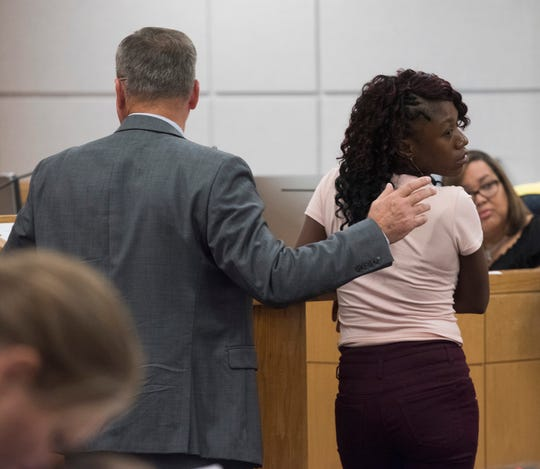 Louvenia Johnson looks back at friends and family before her sentencing on Friday.