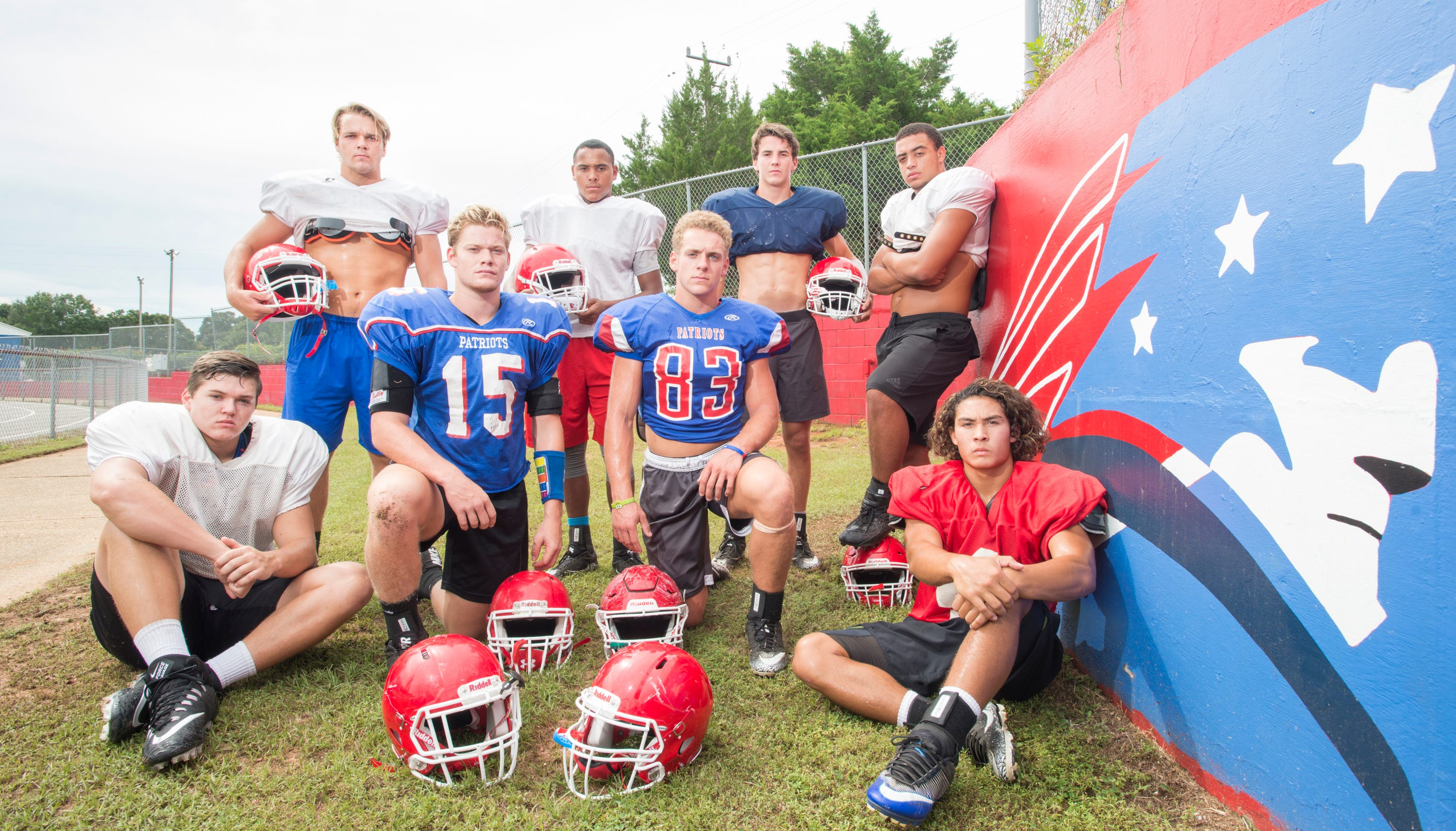 Aidan Gilroy, back from left, Sean Daonaldson, Coltan Bennett, Damean Bivins, and Daniel Tate, front from left, Jake Whitney (15), Earin Holland (83), and Caleb Vincent pose during football practice at Pace High School on Thursday, August 9, 2018.