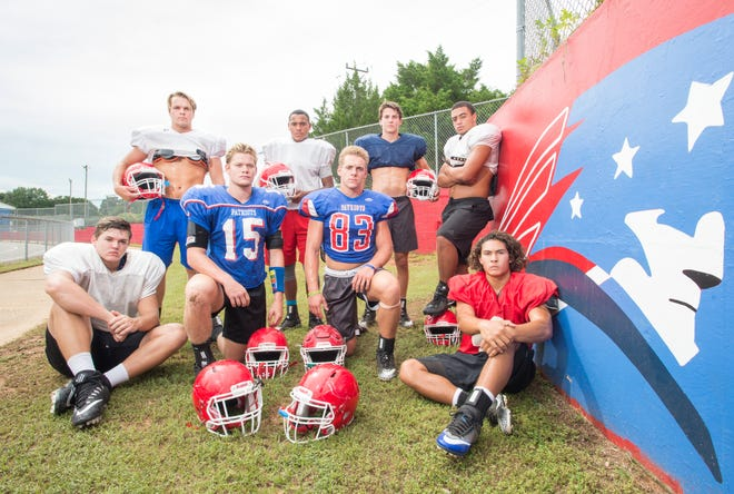 Aidan Gilroy, back from left, Sean Donaldson, Coltan Bennett, Damean Bivins, and Daniel Tate, front from left, Jake Whitney (15), Earin Holland (83), and Caleb Vincent pose during football practice at Pace High School on Thursday, August 9, 2018.