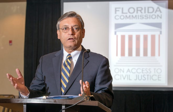 Florida Supreme Court Justice Jorge Labarga, chairman ofthe Florida Commission on Access to Civil Justice, speaks about veterans issues Friday at the Hilton Garden Inn in Pensacola.