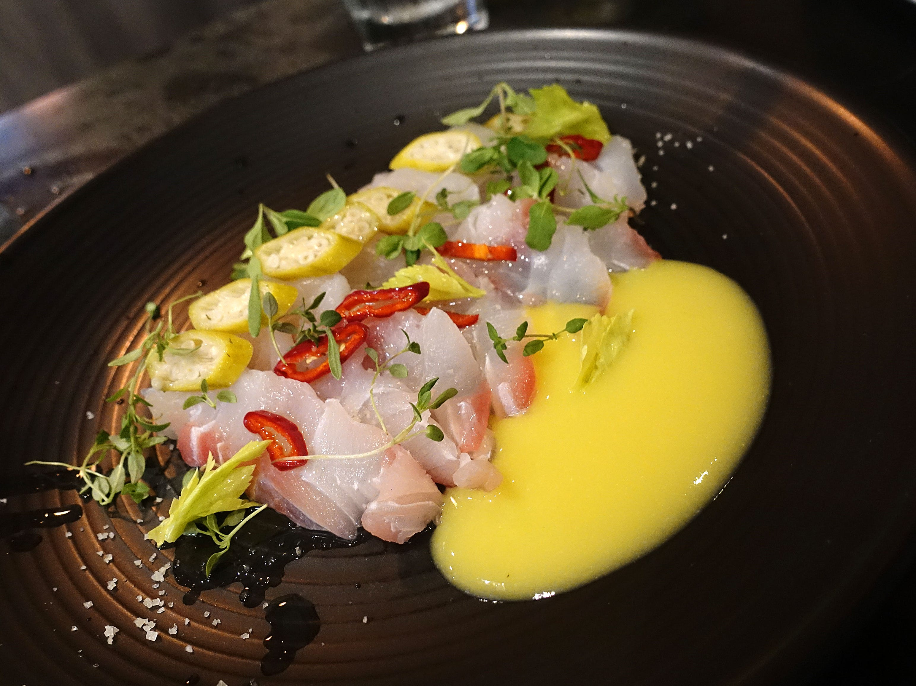 True red snapper crudo with corn juice, pickled okra and aged Fresno chile at The Larder + The Delta in Phoenix.