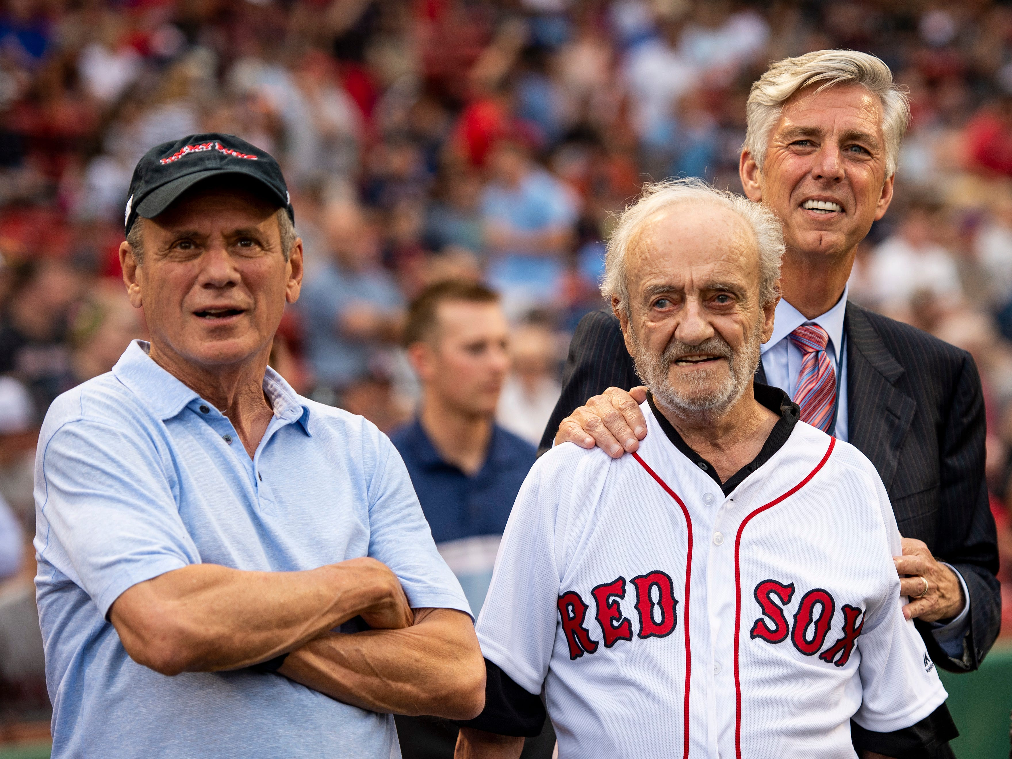 BOSTON, MA - AUGUST 2: Major League Baseball Executive Roland Hemond looks on with Boston Red Sox President & CEO Emeritus Larry Lucchino and Boston Red Sox President of Baseball Operations Dave Dombrowski before throwing out the ceremonial first pitch before a game between the Boston Red Sox and the New York Yankees on August 2, 2018 at Fenway Park in Boston, Massachusetts. (Photo by Billie Weiss/Boston Red Sox/Getty Images) *** Local Caption *** Roland Hemond; Dave Dombrowski; Larry Lucchino