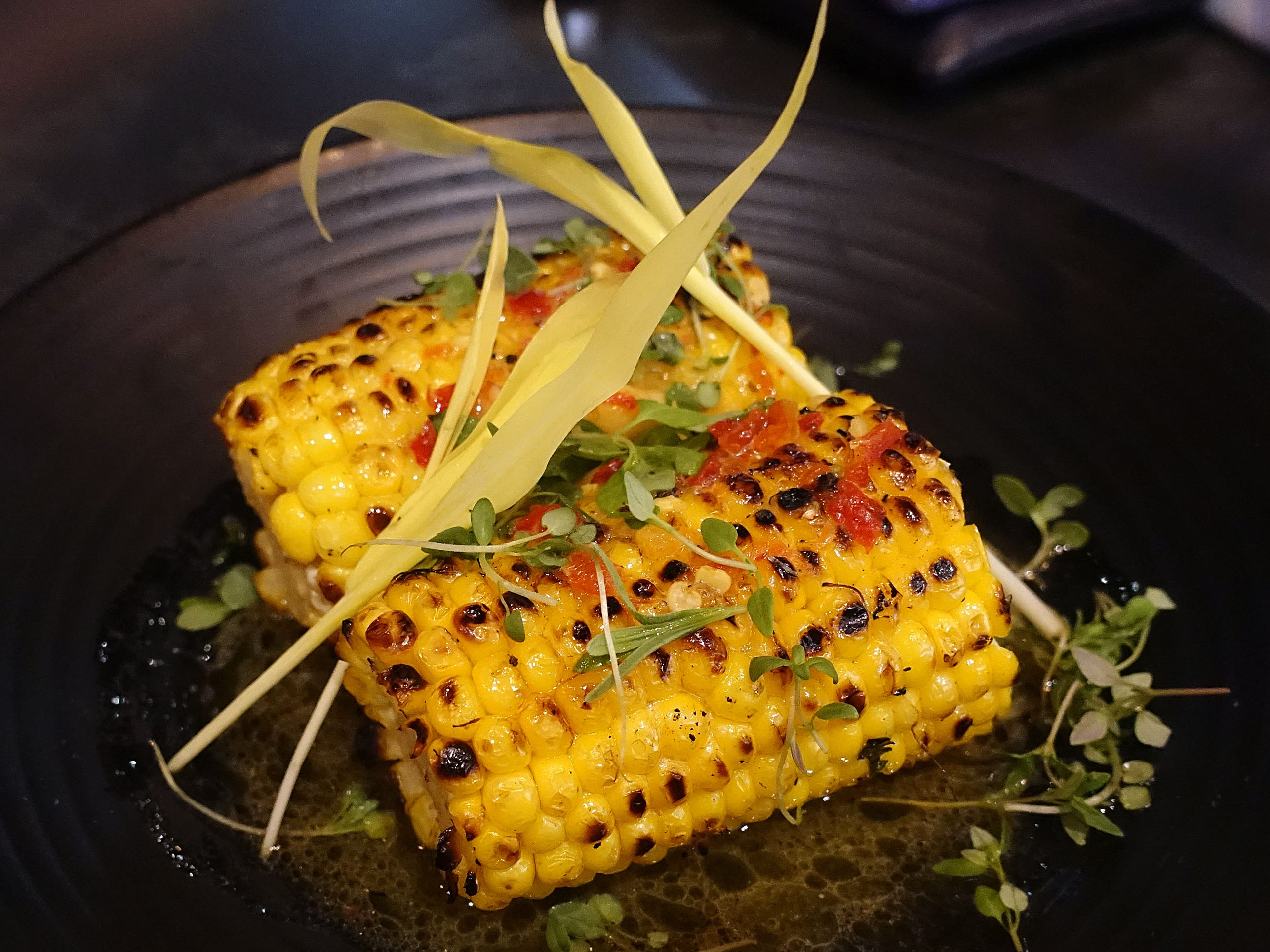Charred local corn with fermented cayenne chile garlic butter and corn shoots at The Larder + The Delta in Phoenix.