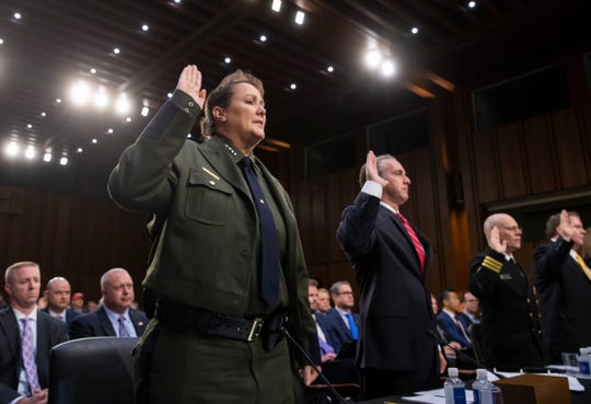 Customs and Border Protection U.S. Border Patrol Acting Chief Carla Provost (left) is sworn in to testify at a hearing on the Trump administration's policies on immigration enforcement and family reunification efforts on July 31, 2018.