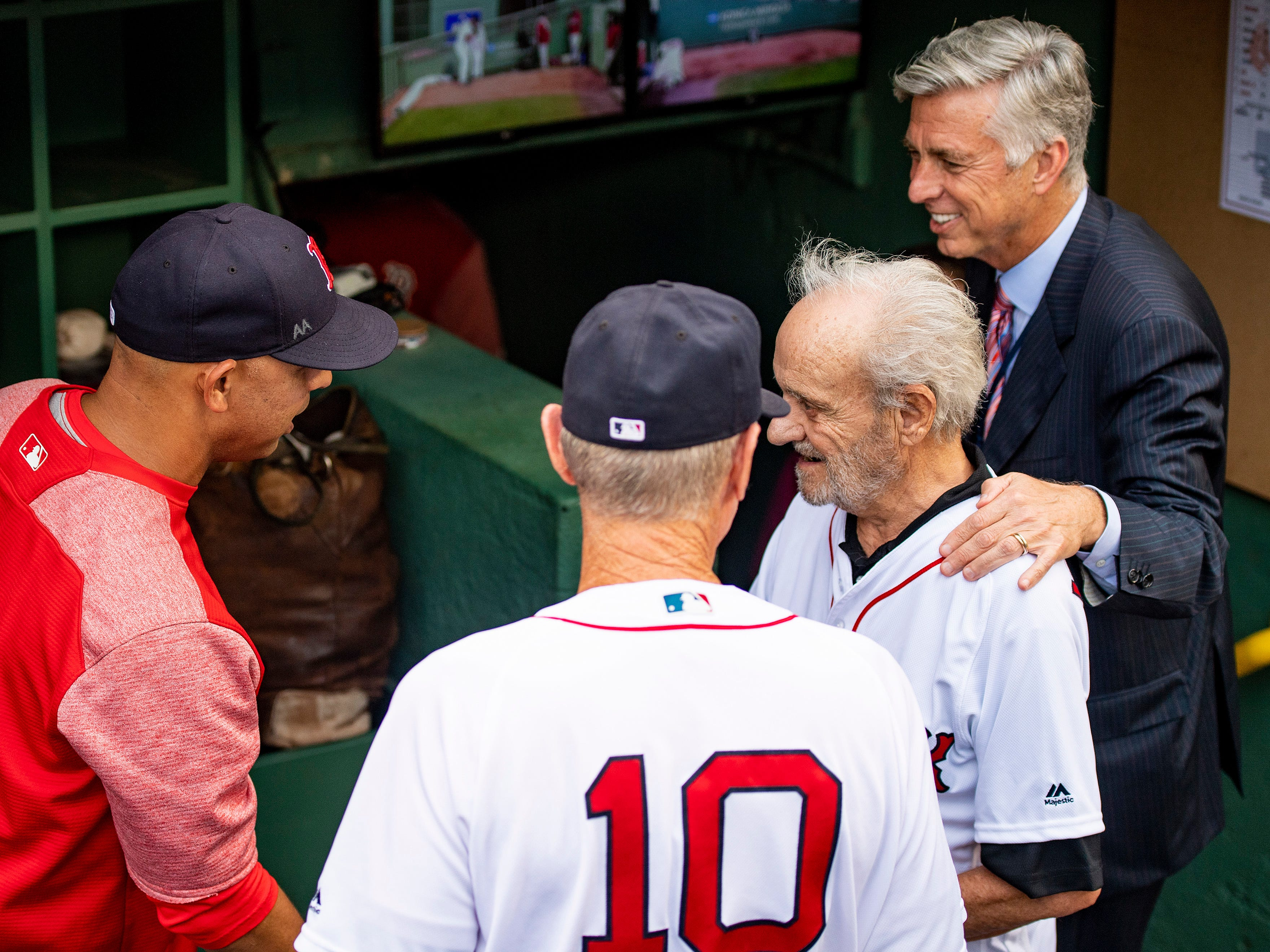 BOSTON, MA - AUGUST 2: Major League Baseball Executive Roland Hemond  is greeted by Boston Red Sox President of Baseball Operations Dave Dombrowski and manager Alex Cora before throwing out the ceremonial first pitch before a game between the Boston Red Sox and the New York Yankees on August 2, 2018 at Fenway Park in Boston, Massachusetts. (Photo by Billie Weiss/Boston Red Sox/Getty Images) *** Local Caption *** Roland Hemond; Dave Dombrowski; Alex Cora
