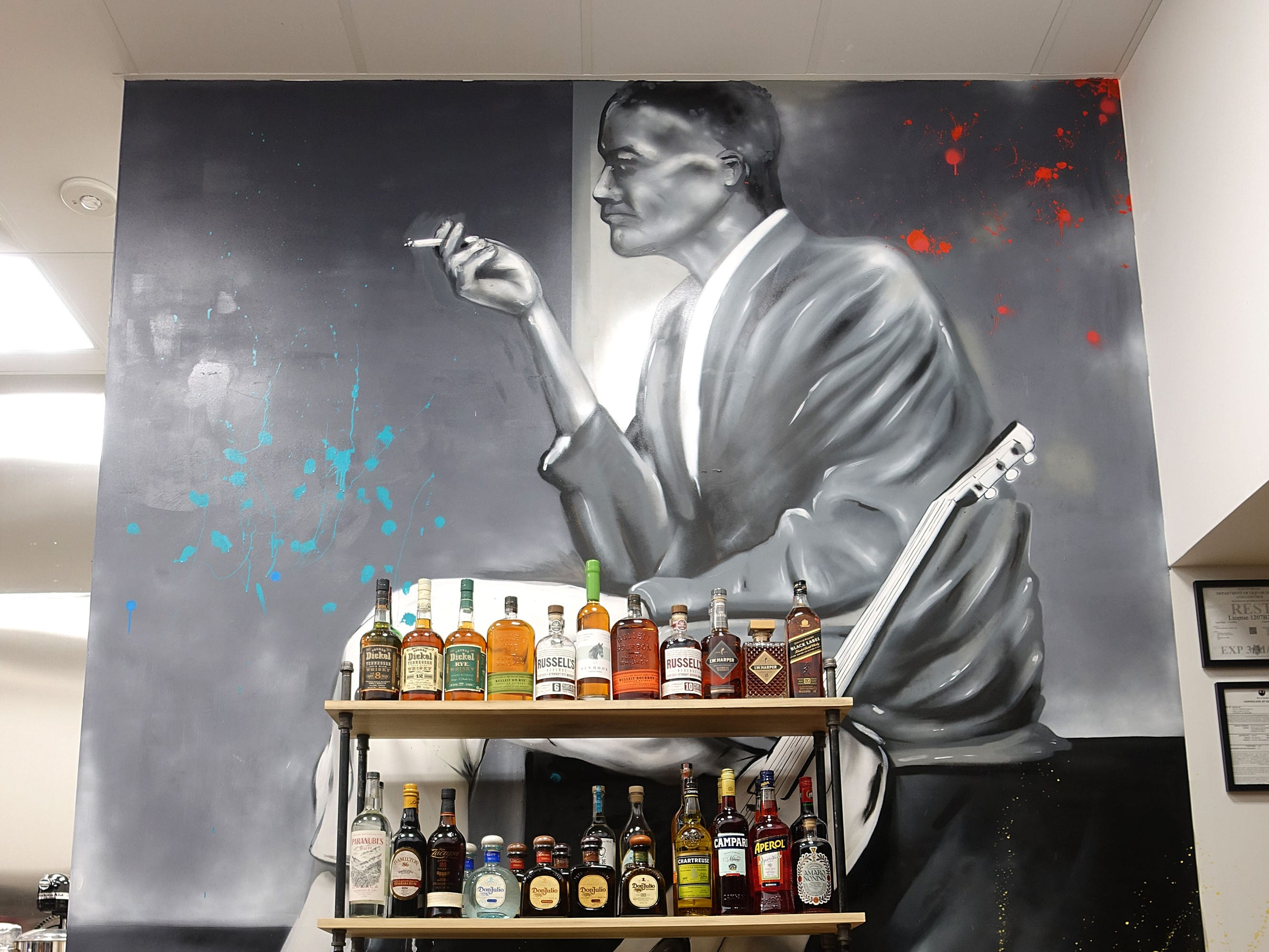 A mural overlooking the bar at The Larder + The Delta in Phoenix.