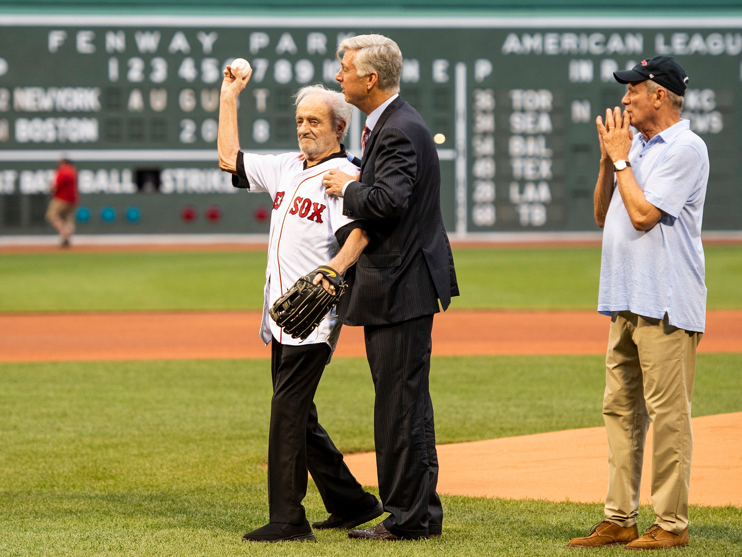 BOSTON, MA - AUGUST 2: Major League Baseball Executive Roland Hemond throws out a ceremonial first pitch alongside Boston Red Sox President & CEO Emeritus Larry Lucchino and Boston Red Sox President of Baseball Operations Dave Dombrowski before throwing out the ceremonial first pitch before a game between the Boston Red Sox and the New York Yankees on August 2, 2018 at Fenway Park in Boston, Massachusetts. (Photo by Billie Weiss/Boston Red Sox/Getty Images) *** Local Caption *** Roland Hemond; Dave Dombrowski; Larry Lucchino