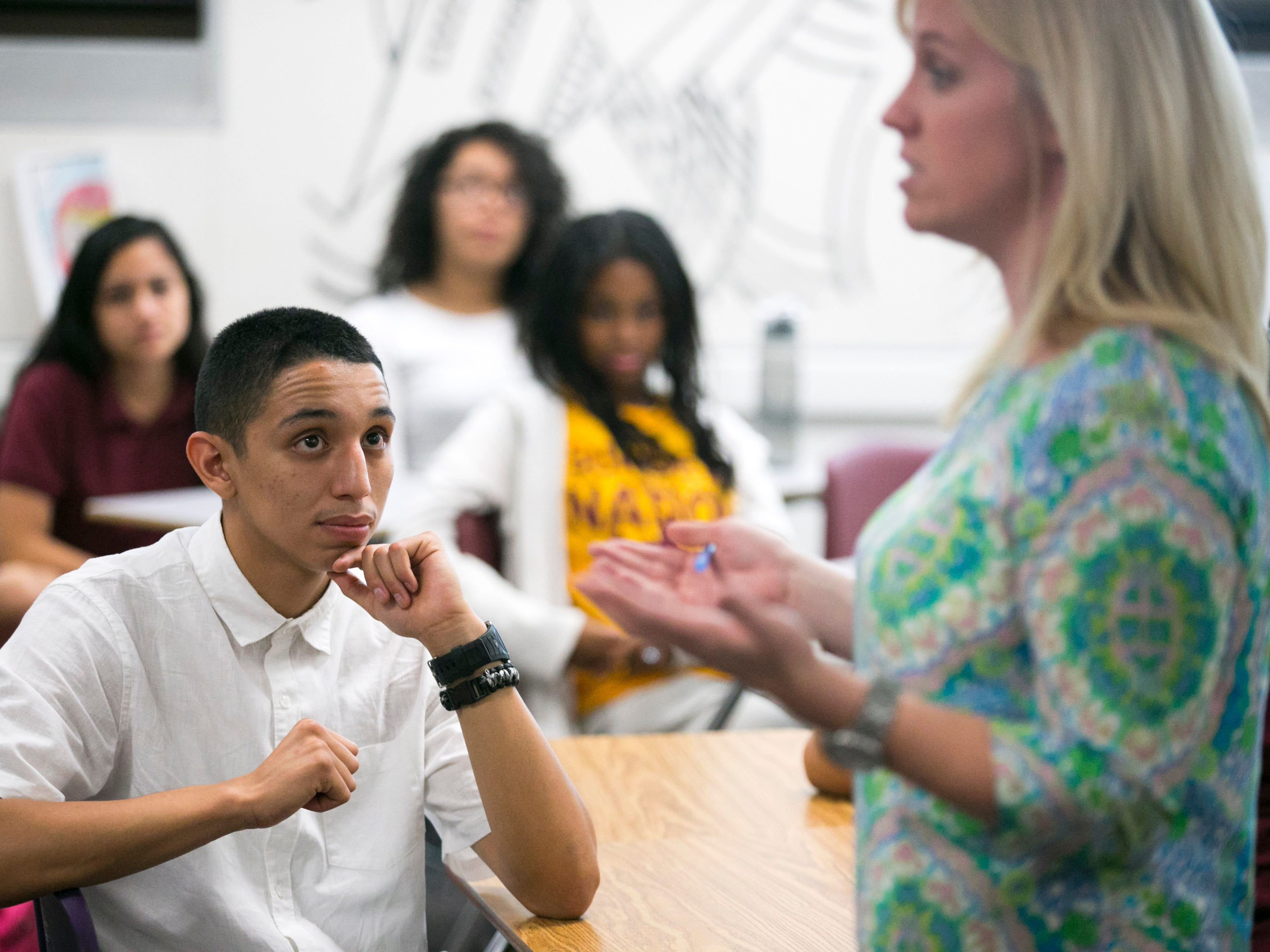 ASU Preparatory Academy senior Brandon Elizalde, 17, listens to math teacher Megan Grothman during class at ASU Preparatory Academy in Phoenix on May 26, 2015.