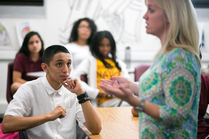 ASU Preparatory Academy senior Brandon Elizalde, 17, listens to math teacher Megan Grothman during class at ASU Preparatory Academy in Phoenix on May 26, 2015.