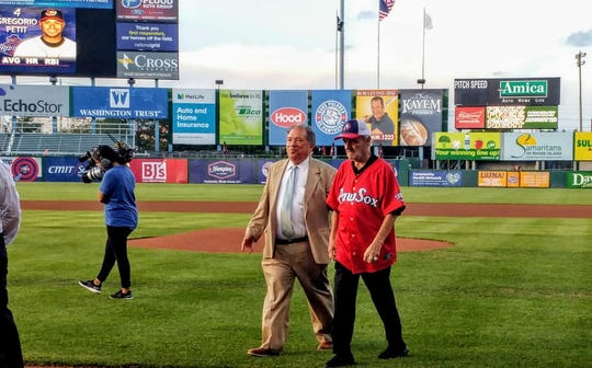 Pawtucket Red Sox President Charles Steinberg escorts MLB executive Roland Hemond after he threw out the first pitch Aug. 3, 2018, in Pawtucket, R.I.