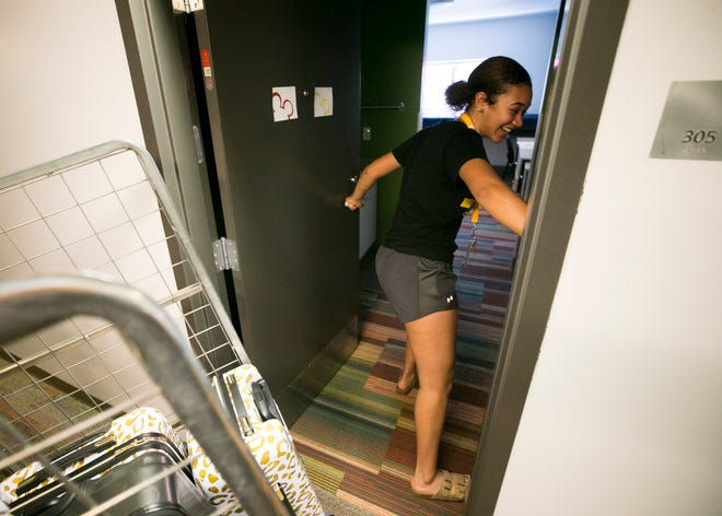 Incoming freshman Jayna Jordan of Pleasant Hill, California, walks into her dorm room for the first time at Taylor Place on the ASU downtown Phoenix campus on Aug. 10, 2018.