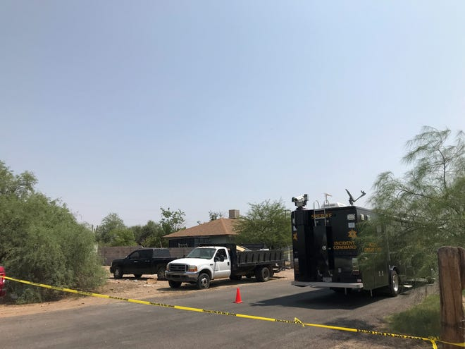 Police marks off the Wittmann home where a triple homicide occurred Thursday evening