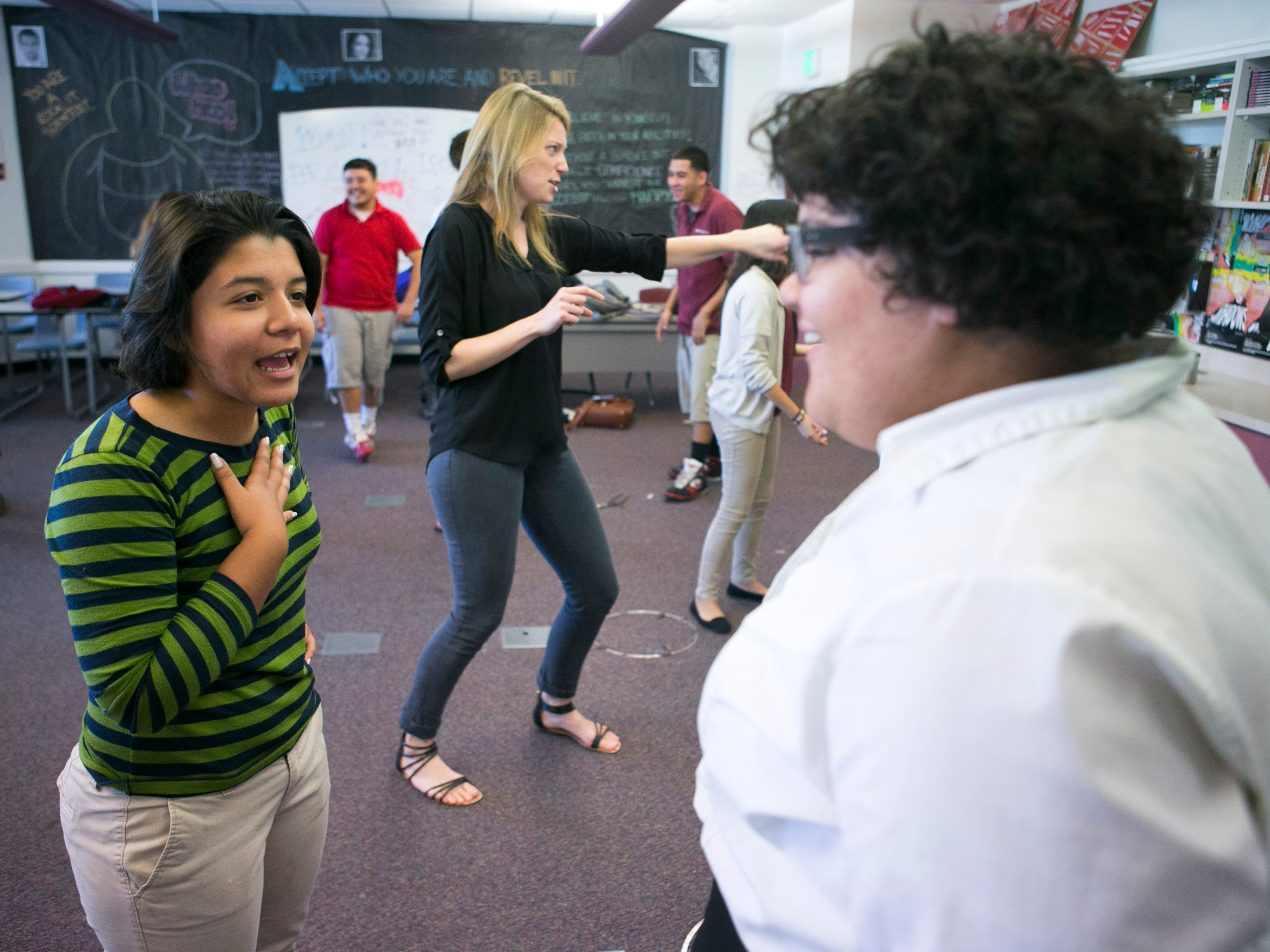 ASU Preparatory Academy senior Donna Flores (left), 18,  does an acting exercise with junior Caelyn Burns, 17, during a drama class at ASU Preparatory Academy in Phoenix on May 26, 2015.
