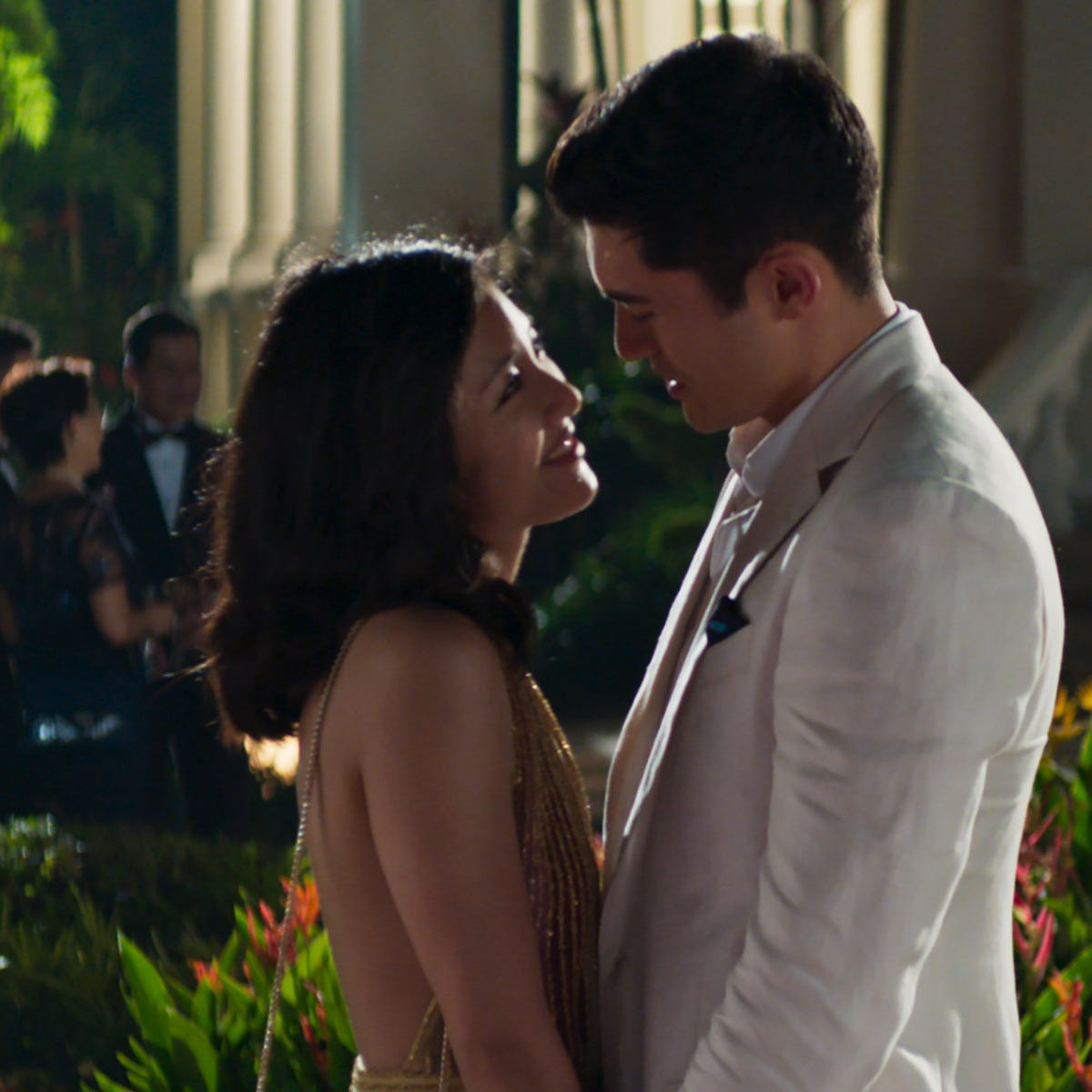 """Rachel (Constance Wu) and Nick (Henry Golding) head to Singapore for a wedding in """"Crazy Rich Asians."""""""