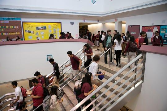 Students walk between classes at ASU Preparatory Academy in Phoenix on May 26, 2015.
