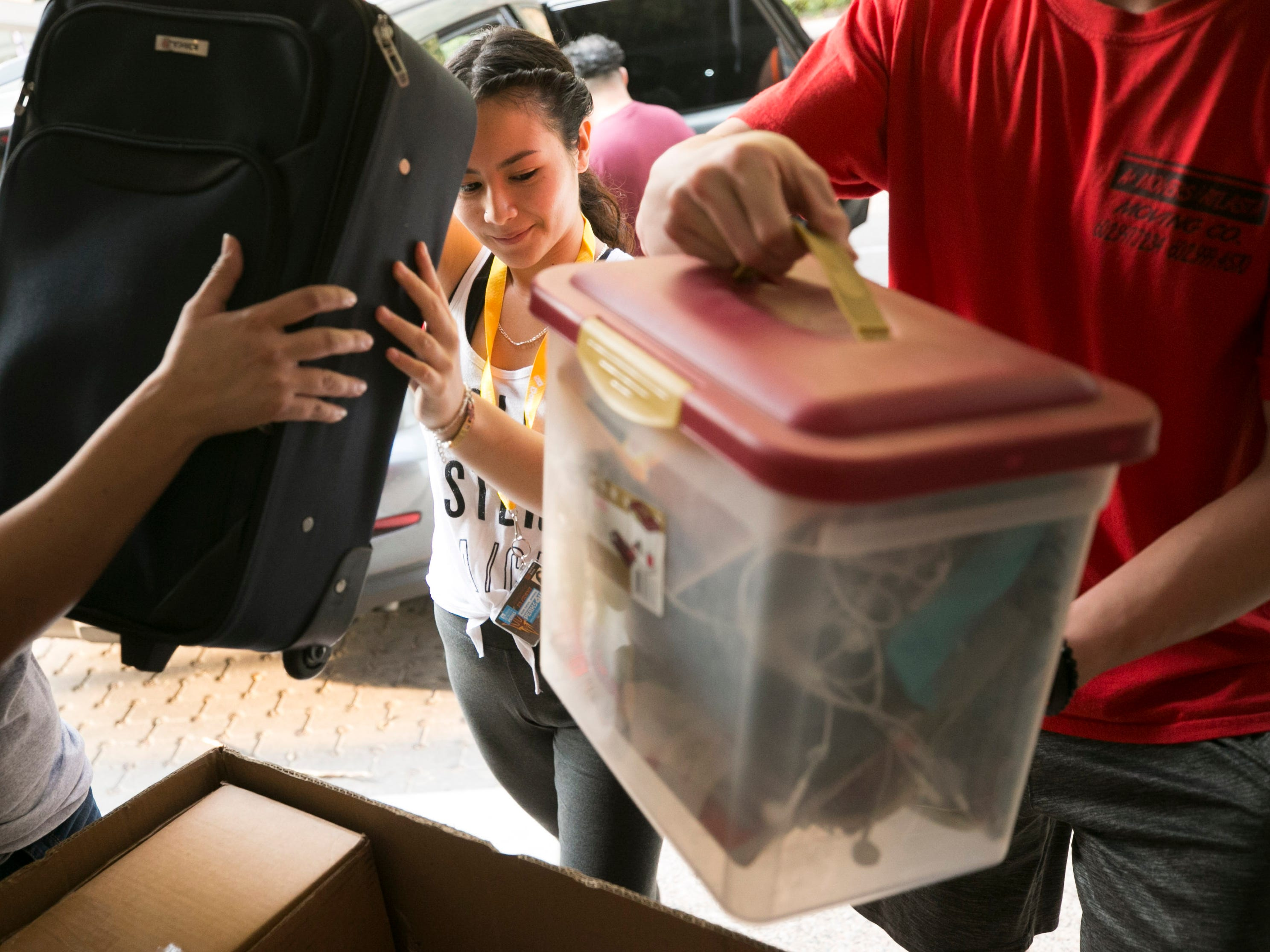 Incoming freshman Melissa Galdamez of Avondale helps get her stuff moved into her ASU dorm at Taylor Place on the ASU campus in downtown Phoenix on Aug. 10, 2018.