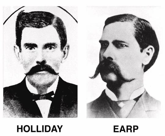 Doc Holliday, ex-dentist and western gunfighter, and frontier lawman Wyatt Earp are shown in portraits made after the infamous gunfight at the O.K. Corral in Tombstone, Arizona, in 1881, in which the fought in a shootout with the Clanton gang.