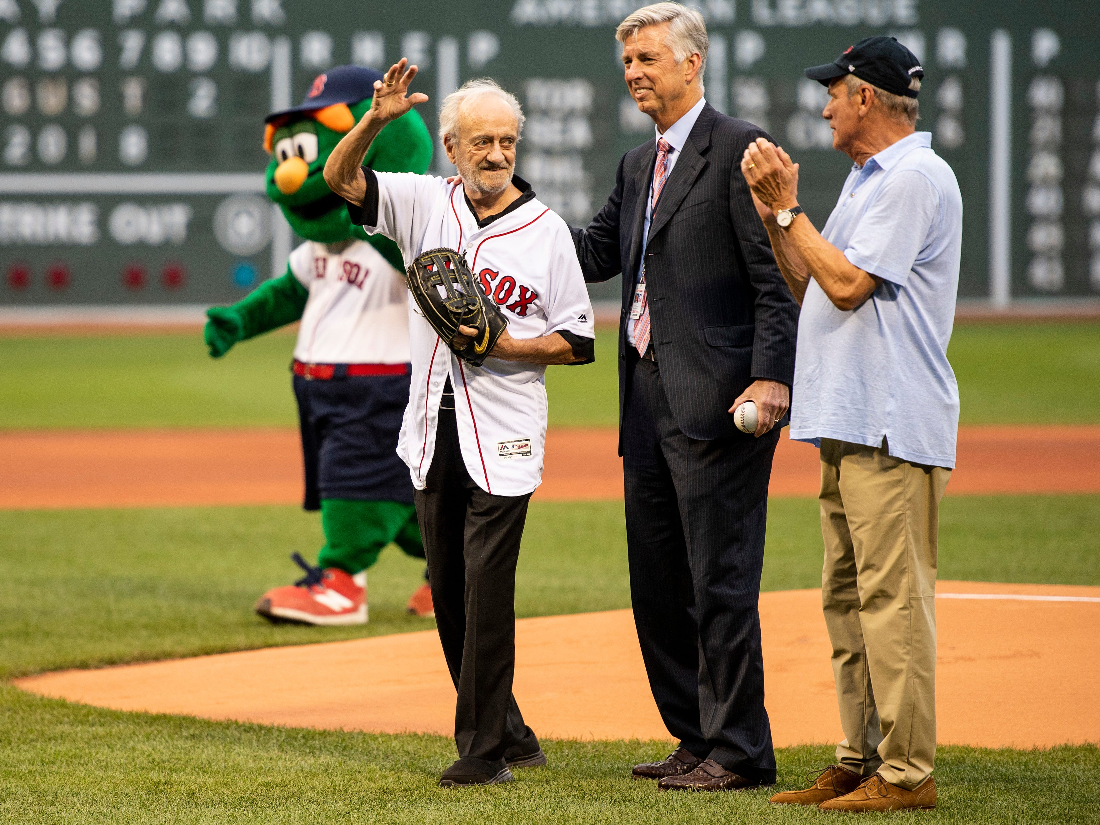 BOSTON, MA - AUGUST 2: Major League Baseball Executive Roland Hemond is introduced alongside Boston Red Sox President & CEO Emeritus Larry Lucchino and Boston Red Sox President of Baseball Operations Dave Dombrowski before throwing out the ceremonial first pitch before a game between the Boston Red Sox and the New York Yankees on August 2, 2018 at Fenway Park in Boston, Massachusetts. (Photo by Billie Weiss/Boston Red Sox/Getty Images) *** Local Caption *** Roland Hemond; Dave Dombrowski; Larry Lucchino