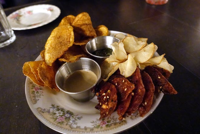 Pub chips (clockwise from top left: potato, root vegetable and salami) with honey mustard and pesto at Cotton & Copper in Tempe.