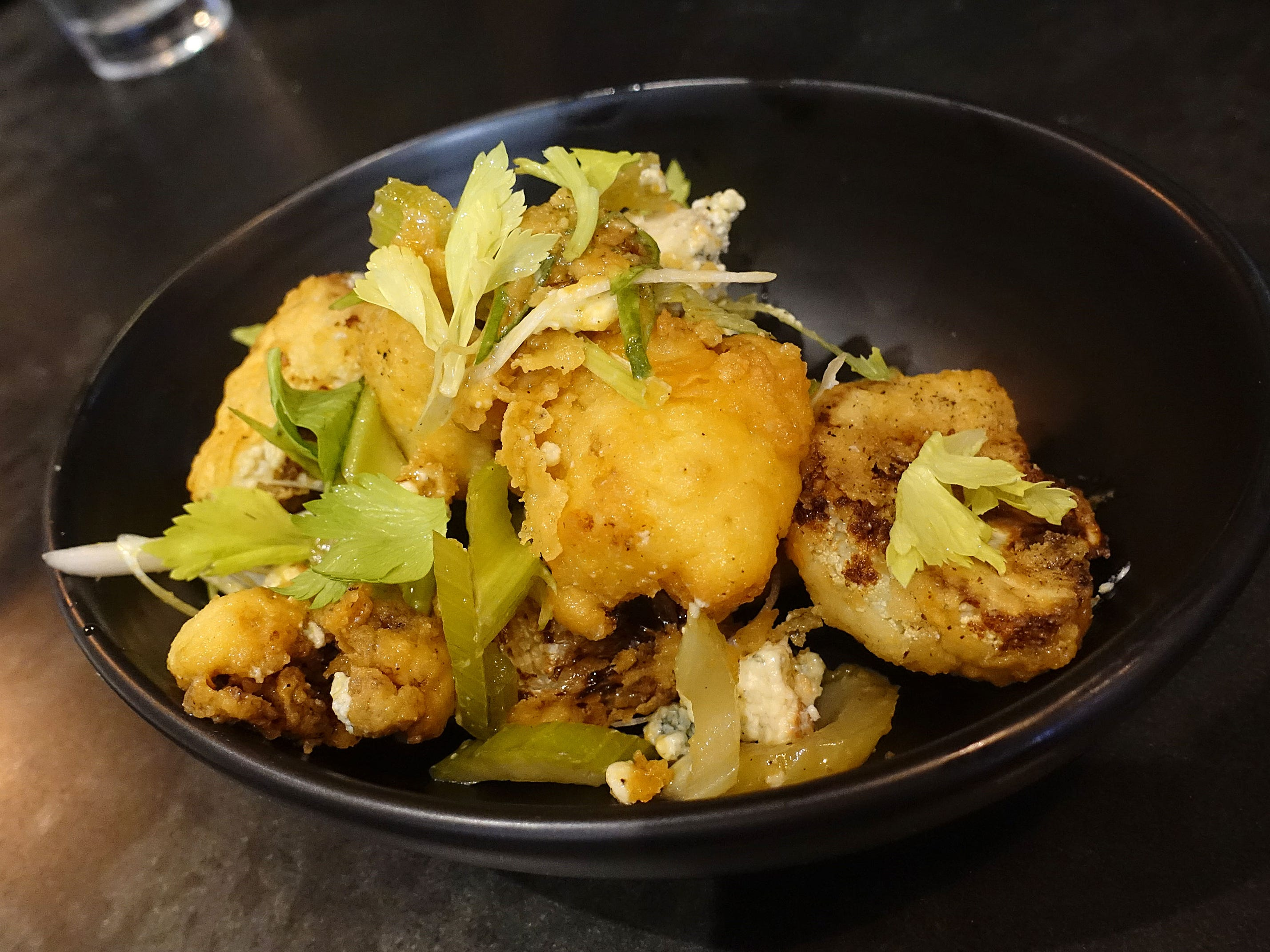 Cauliflower with Rogue Creamery smokey blue, pickled celery and Cutino's hot sauce at The Larder + The Delta in Phoenix.