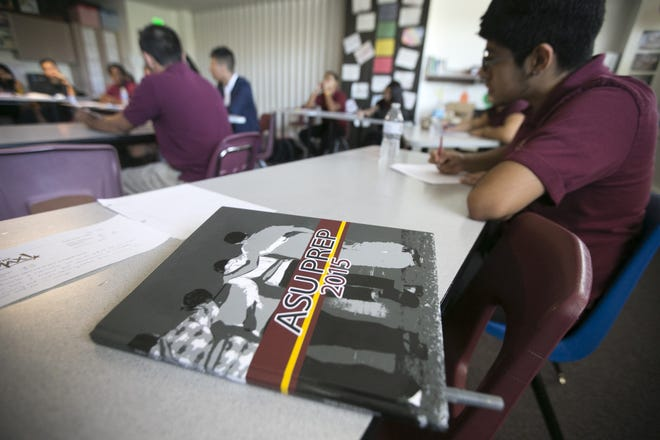 A yearbook sits on a desk in a senior English class at ASU Preparatory Academy in Phoenix on May 26, 2015.