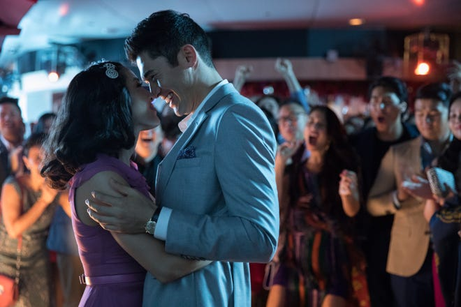 """In """"Crazy Rich Asians,"""" Nick (Henry Golding) hasn't told girlfriend Rachel (Constance Wu) about his family."""