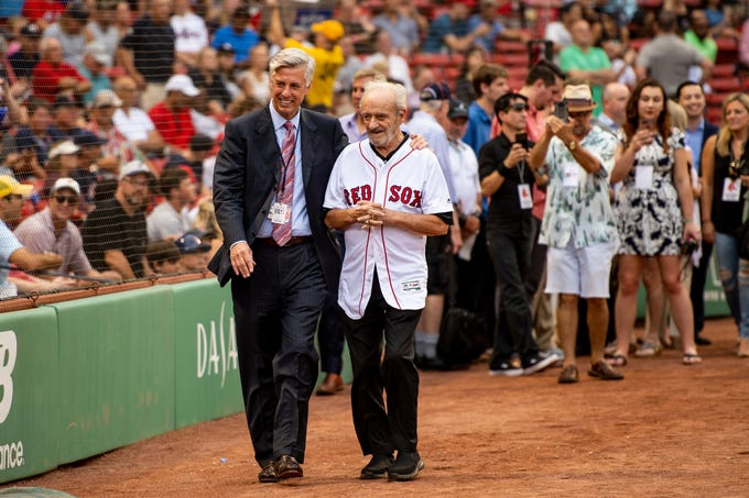BOSTON, MA - AUGUST 2: Major League Baseball Executive Roland Hemond  walks with Boston Red Sox President of Baseball Operations Dave Dombrowski before throwing out the ceremonial first pitch before a game between the Boston Red Sox and the New York Yankees on August 2, 2018 at Fenway Park in Boston, Massachusetts. (Photo by Billie Weiss/Boston Red Sox/Getty Images) *** Local Caption *** Roland Hemond; Dave Dombrowski