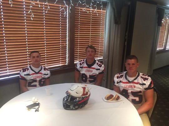 Lebanon High players, from left, Christian Manzolillo, Gabriel Calini, and Andrew Bowers pose for a picture at Lancaster-Lebanon League Football Media Day on Friday.