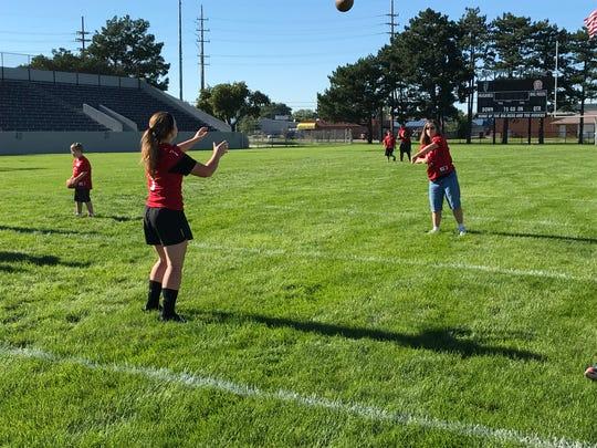Molly Cadena plays catch with Port Huron sophomore Kasey Szczepkowski during Victory Day.