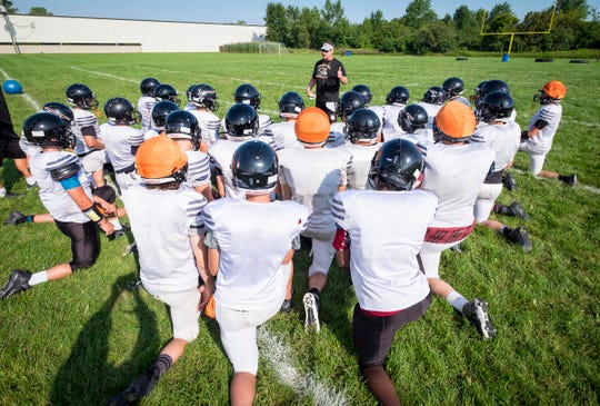 Marine City coach Ron Glodich addresses the team during a practice Friday, Aug. 10, 2018, at Marine City High School.