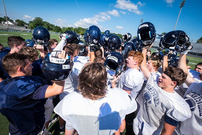 The Marysville High School football team huddle at the end of a practice Friday, Aug. 10, 2018, at Marysville High School.