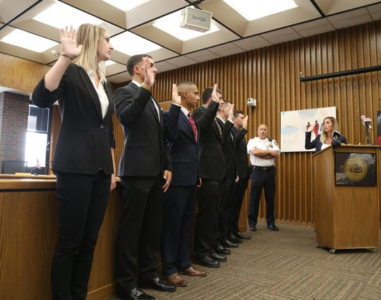 City of Poughkeepsie chamberlain, Deanne Flynn, swears in six new police officers, from left, Amanda Rose, Shane Rightmeyer, Michael McDonough-Ewald, Patrick Harden, Joe Lucchesi and Eric Marsh at City Hall on Aug. 10, 2018.