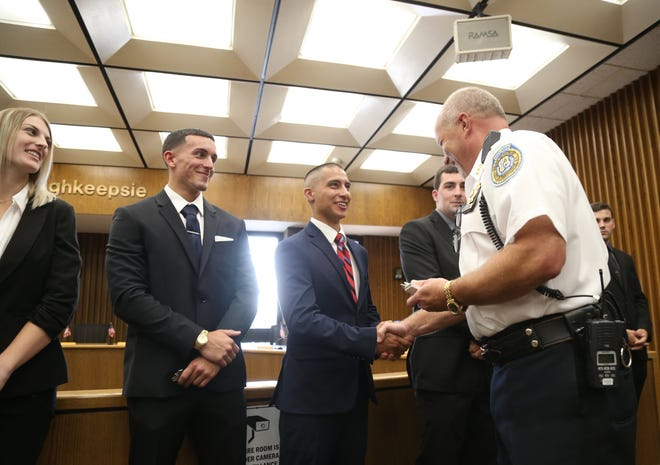City of Poughkeepsie Police Chief Thomas Pape congratulates new officer Michael McDonough-Ewald during a swearing in ceremony at City Hall on Aug. 10, 2018.