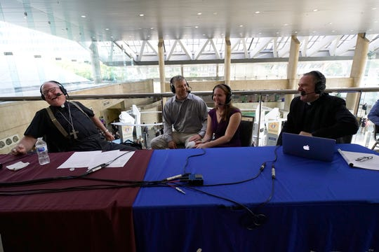 Cardinal Timothy Dolan and his co-host, the Rev. David Dwyer share a laugh with Ryan and Elizabeth Young of Poughkeepsie during the Aug. 8 event in Baltimore.