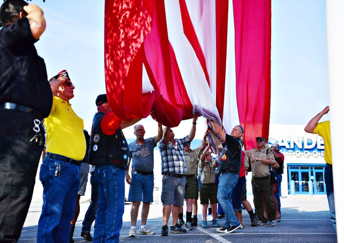 Gander Outdoors ceremoniously raises 80 by 40 foot American flag at their store in West Manchester Township, Friday, Aug. 10, 2018. Dawn J. Sagert