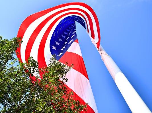 Gander Outdoors Raises Flag