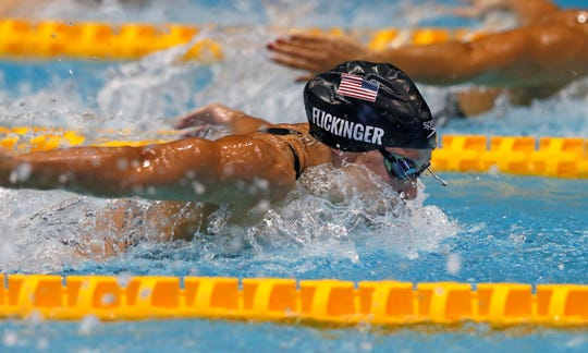 U.S. swimmer Hali Flickinger swims on her way to winning the women's 200m butterfly final during the Pan Pacific swimming championships in Tokyo, Friday, Aug. 10, 2018.(AP Photo/Koji Sasahara)
