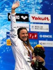 U.S. swimmer Hali Flickinger, a Spring Grove High School graduate, waves on the podium after winning the women's 200-meter butterfly final during the Pan Pacific Swimming Championships in Tokyo, on Friday, Aug. 10, 2018. (AP Photo/Koji Sasahara)