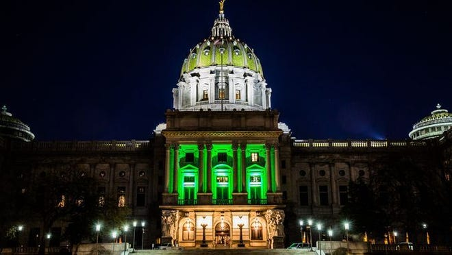 The Pennsylvania State Capitol in Harrisburg bathed in green lights to celebrate the passage of PA's medical marijuana law in 2016