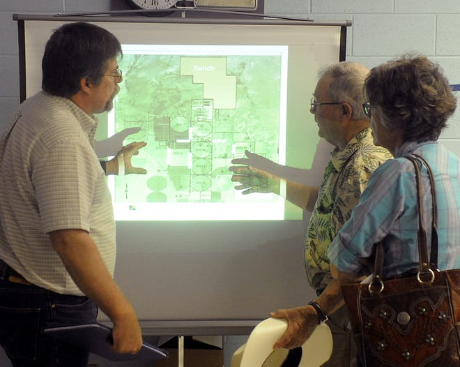 Smith Valley residents look at a map of the proposed expansion area after the public hearing.