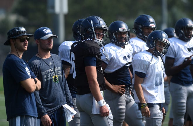 Nevada quarterback Ty Gangi (6) and teammates watch a play develop during practice earlier this week.